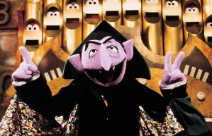 "Sesame Street's Count von Count holds up three fingers in his new ""Number of the Day"" segment, in the show's 33rd season. [PNG Merlin Archive]"